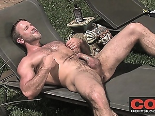 Hot musicle stud Dirk Caber jerks his meat out in the sun gays (gay) masturbation (gay) solo (gay)